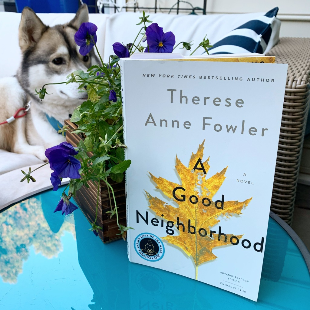 Photo of the book A Good Neighborhood by Therese Anne Fowler with flowers and husky