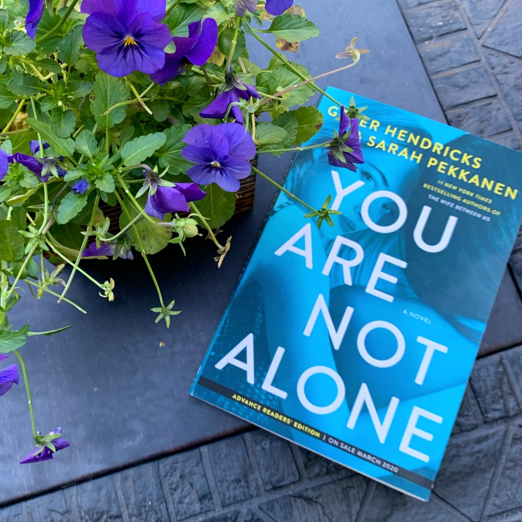 "Photo of the book ""You Are Not Alone"" by Greer Hendricks and Sarah Pekkanen"
