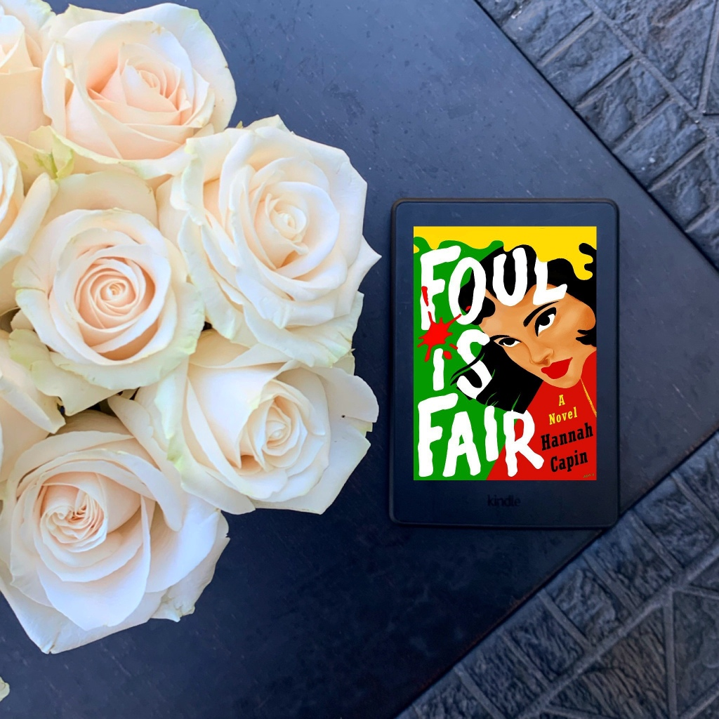 Photo of Foul is Fair by Hannah Capin on Kindle with white roses