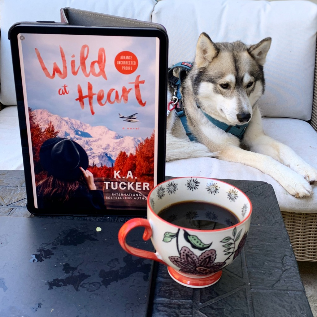 Photo of Wild At Heart ebook on iPad, husky, and a cup of coffee