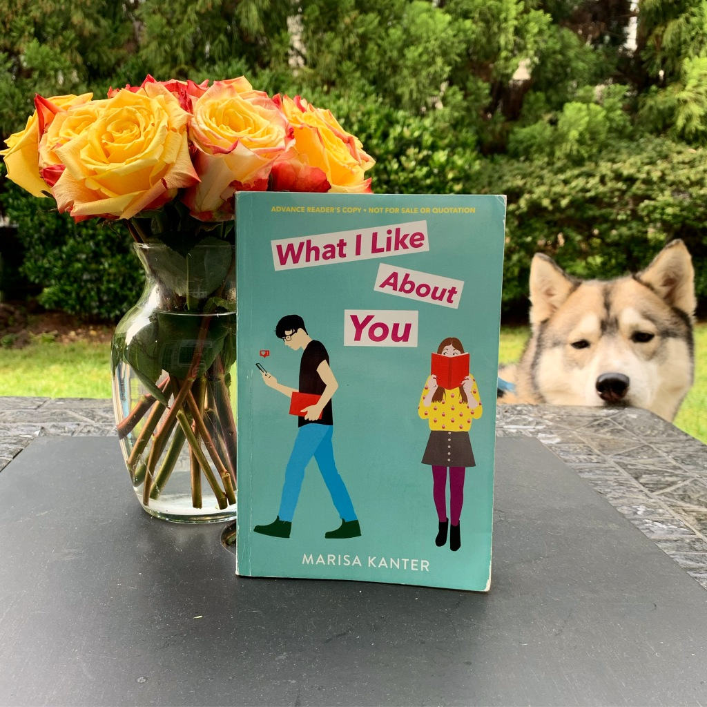 What I Like About You book by Marisa Kanter with flowers and husky