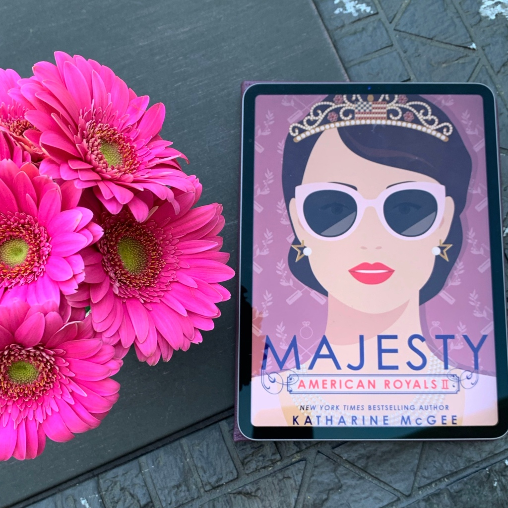 American Royals II: Majesty by Katharine McGee ebook on iPad with pink flowers