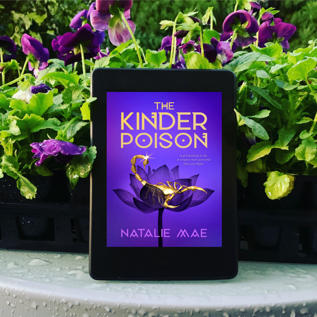 The Kinder Poison by Natalie Mae on Kindle with flowers