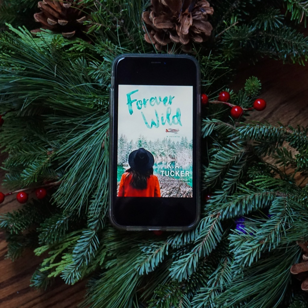 Forever Wild ebook on iPhone with Christmas pine wreath