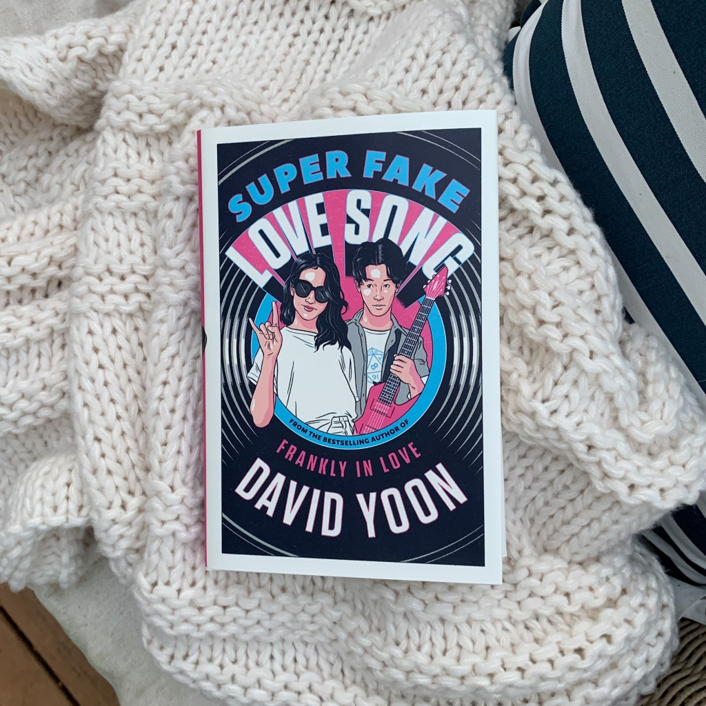 Super Fake Love Song by David Yoon hardcover on blanket