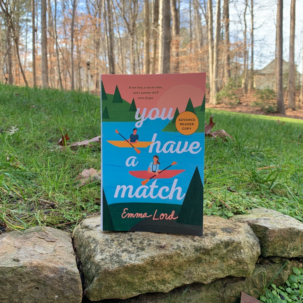 You Have a Match by Emma Lord paperback on rocks