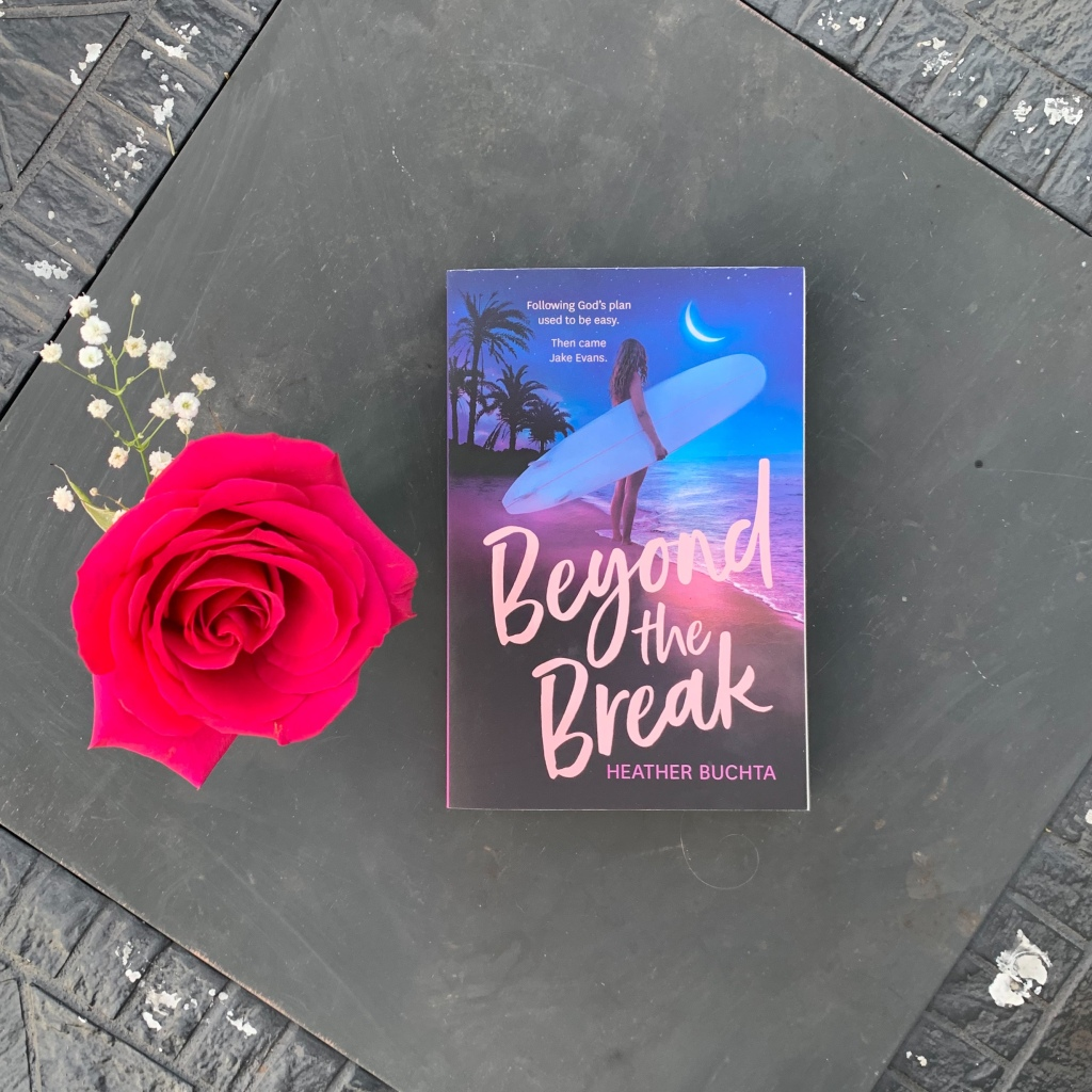 Photo of Heather Buchta's Beyond the Break paperback book with a rose