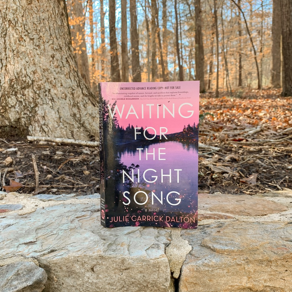 Photo of Waiting for the Night Song by Julie Carrick Dalton paperback ARC copy in the woods