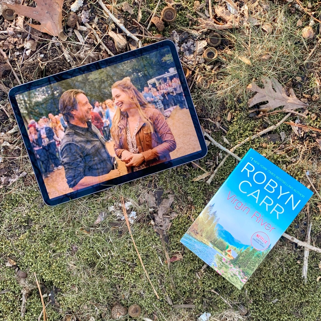 Photo from Virgin River tv show on Netflix and paperback copy of the book by Robyn Carr