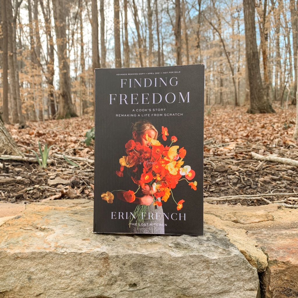 Finding Freedom by Erin French hardcover book in the woods with gold leaves